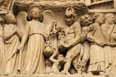 Gothic Art. France. Paris. Notre Dame. Sculptures decorating the portal of the Last Judgment. It was built in the 1220s-1230s. Facade. The archangel Michael is weighing their souls with a furry Devil's interference. Paris.. Credit: Album / Prisma