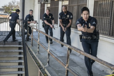 "S.W.A.T., a new drama inspired by the television series and the feature film, stars Shemar Moore (second from right) as a locally born and raised S.W.A.T. sergeant newly tasked to run a specialized tactical unit that is the last stop in law enforcement in Los Angeles. His elite unit includes Christina ""Chris"" Alonso (Lina Esco, far left), David ""Deacon"" Kay (Jay Harrington, second from left), Dominique Luca (Kenny Johnson, center) and Victor Tan (David Lim, far right). This fall, S.W.A.T. will be broadcast Thursdays (10:00-11:00 PM, ET/PT) beginning Nov. 2, after football concludes, on the CBS Television Network. Photo: Michael Yarish/CBS ©2017 CBS Broadcasting, Inc. All Rights Reserved"