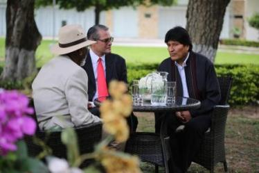 Santa Cruz De La Sierra, Bolivia - Morgan Freeman interviews the President of Bolivia, Evo Morales, with the help of interpreter Miguel Aguirre.(National Geographic/Maria Bohe)